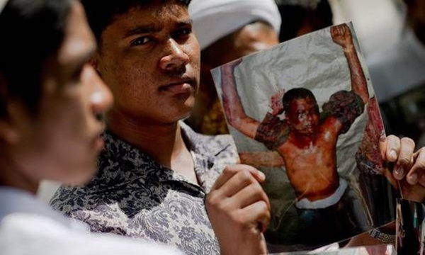 Rohingya protesters gather in front of a