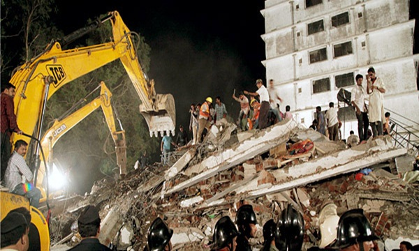 A dead body under the rubble after an eight-storey unauthorised under-construction building collapsed in Shil Phata area of Mumbra, in Thane district, oustskirts of Mumbai.